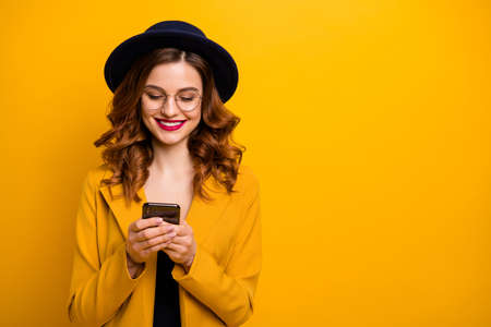 Close up  beautiful she her toothy lady arms hands telephone check  followers perfect red lips pomade wear specs formal-wear costume suit isolated yellow vivid vibrant background