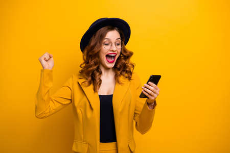 Close up photo beautiful yelling she her lady watch arms hands telephone reader cool news modern look sale discount lottery wear specs formal-wear costume suit isolated yellow vibrant background