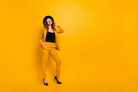Full length body size photo beautiful amazing she her lady street perfect look tourism traveler not smiling hands arms pockets wear specs formal-wear costume suit isolated yellow bright background