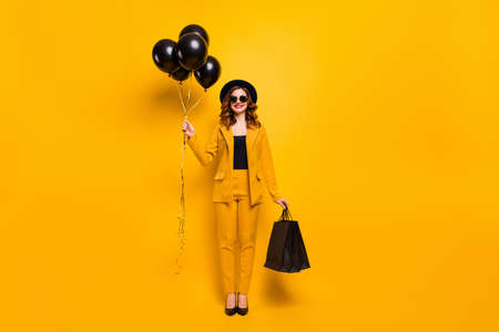 Full length body size photo beautiful she her lady toothy carry packs perfect look best guest birthday party presents balloons wear specs formal-wear costume suit isolated yellow bright background