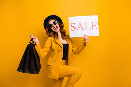 Close up side profile photo beautiful she her lady recommend black friday packs paper promo low prices buy buyer sale discount wear specs formal-wear costume suit isolated yellow bright background 版權商用圖片