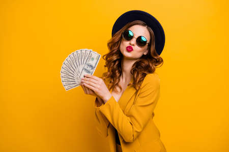Close up photo beautiful she her lady abroad vacation traveler red allure kiss buy present gift fan usa bucks sale discount high social status wear specs formal-wear isolated yellow bright background Фото со стока