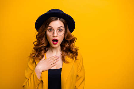 Close-up portrait of nice charming cute attractive lovely winsome chic elegant gorgeous amazed wavy-haired lady wearing yellow blazer opened mouth isolated on bright vivid shine orange background