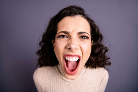 Close up photo beautiful wild she her lady yelling loud not fair situation roar I would kill you facial expression open mouth furious crazy mad wear casual pastel pullover isolated grey background