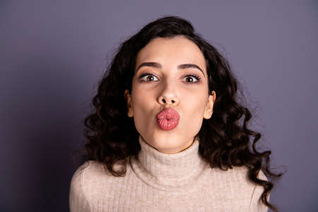 Close up photo attractive positive she her nice lady send air kiss friends boyfriend husband fiance funny facial expression weekend mood wear casual pastel sweater pullover isolated grey background