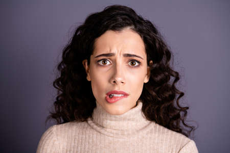 Close up photo amazing attractive she her lady biting lips oh no facial expression eyes full fear not my fault awful terrible situation wear casual pastel sweater pullover isolated grey background