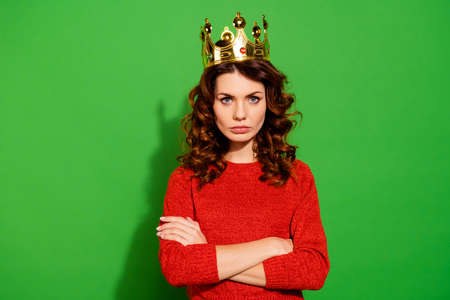 Portrait of her she nice-looking lovely winsome pretty attractive serious bossy selfish wavy-haired girl in red sweater crown feminism isolated on bright vivid shine green background