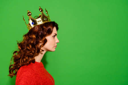 Profile side view close-up portrait of her she nice-looking lovely winsome pretty attractive serious purposeful wavy-haired girl in red sweater crown isolated on bright vivid shine green background