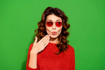 Close-up portrait of her she nice-looking lovely lovable sweet winsome attractive cheerful girlish feminine wavy-haired girl in red sweater looking aside isolated on bright vivid shine green background
