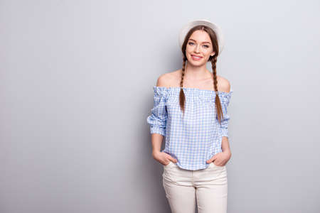 Portrait cute nice pretty lady person content satisfied rejoice enjoy free time weekend holiday place hands palms pocket beige trousers modern ckeckered shirt off-shoulders isolated argent background