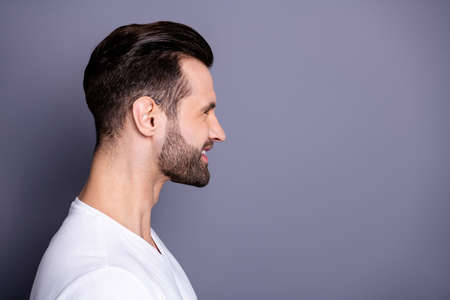 Close up side profile photo amazing he him his wondered funny macho perfect ideal appearance easy-going reliable person reveal teeth laughter wear casual white t-shirt isolated grey background