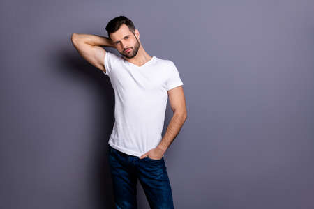 Portrait of gorgeous nice charming pretty man millennial he his good-looking touch head neck palm hand wear fashionable modern clothing isolated grey background 免版税图像 - 129609545