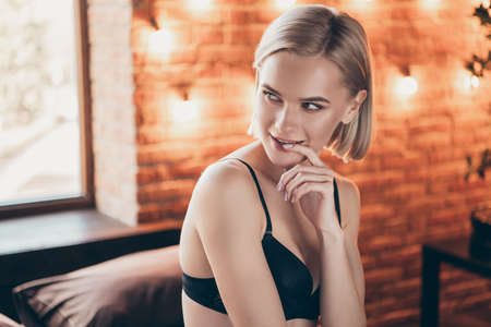Close up side profile photo beautiful gorgeous amazing she her lady, bite finger teeth look husband boyfriend gentle tempting eyes seduce sitting sheets perfect ideal body bikini boudoir room indoors Фото со стока