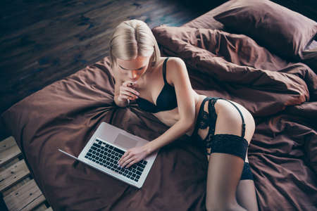Top above high angle view of her she nice-looking graceful curvy luxury stunning gorgeous attractive feminine lovely lady lying on bed chatting with boyfriend on sheets linen