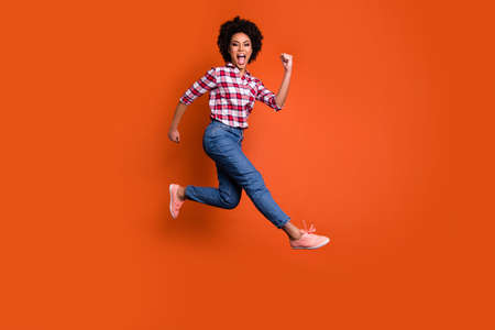 Full length profile photo of jumping high model lady yelling sale discount wear casual pants shirt clothes outfit isolated orange background
