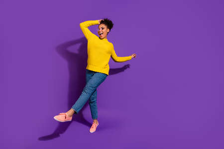 Full length body size view portrait of her she nice attractive lovely cheerful cheery carefree wavy-haired lady having fun time isolated over bright vivid shine violet background