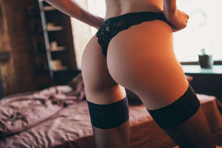 Close up back rear behind view photo beautiful desire tender love me honey, she her wife ass hold hands romantic surprise wish want wait husband home black lace bikini room indoors linen bedroom