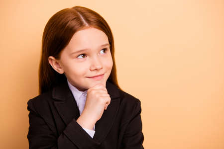 Close-up portrait of her she nice attractive lovely dreamy cheerful, cheery sweet pre-teen girl wearing formal wear science knowledge learning isolated over beige pastel background