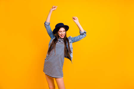 Portrait of her she nice-looking fascinating charming smart attractive lovely cheerful cheery straight-haired lady having fun disco isolated over bright vivid shine yellow background