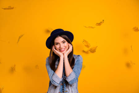 Portrait of her she nice charming attractive lovely glad delighted cheerful cheery straight-haired lady enjoying among seasonal leaves isolated over bright vivid shine yellow background Stock Photo