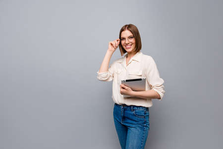 Close up side profile photo beautiful cheer she her business lady chief e-reader hands arms reader classroom lesson lecture learn wear specs casual jeans denim white shirt isolated grey background Фото со стока