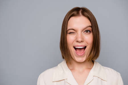 Close up photo beautiful amazing she her lady funny funky weekend vacation mood winking one eye ideal perfect appearance excited laugh laughter wear casual white shirt isolated grey background