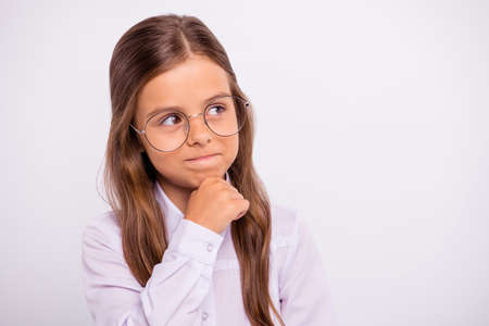 Close-up portrait of her she nice attractive sweet lovely cheery intellectual pre-teen girl thinking science creativity decide isolated over light white grey background Stok Fotoğraf
