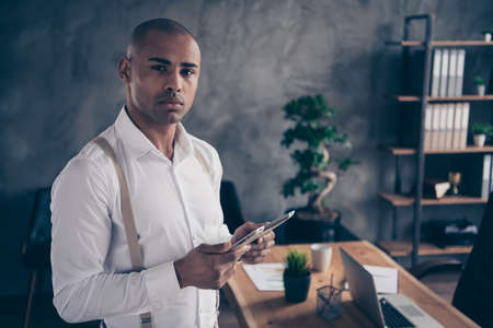 Close-up portrait of his he nice attractive stylish confident chic classy guy shark expert executive top director reading e-book finance report at industrial loft interior work place station