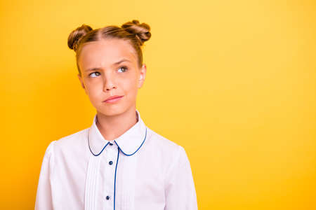 Close-up portrait of her she nice-looking attractive lovely moody doubtful pre-teen girl wearing white shirt solving task isolated on bright vivid shine yellow background