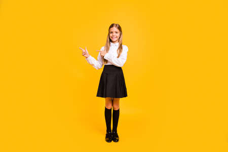 Full length body size view of her she nice attractive confident cheerful straight-haired pre-teen girl pointing advert solution sale discount isolated over bright vivid shine yellow background