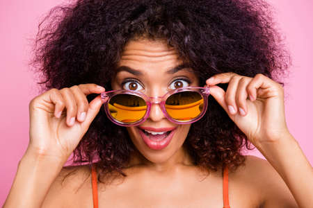 Close up photo funny beautiful she her dark skin lady go seaside beach wish suntan exotic island resort no people water cool news wear sun specs swimming orange suit brassiere isolated pink background