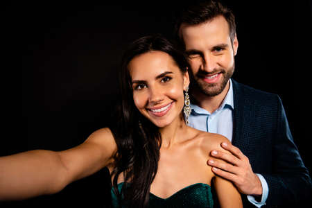 Close up photo rich pair classy she her beautiful he him his macho toothy make take selfies enjoy anniversary party chill wear blue plaid costume jacket velvet green dress isolated black background Reklamní fotografie