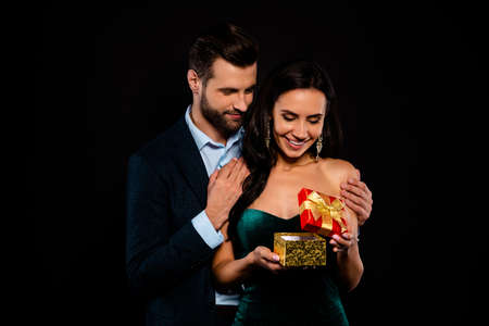 Close up photo beautiful she her classy chic lady he him his groomed macho deliver receive giftbox satisfied glad wear plaid blue costume jacket velvet green shine dress isolated black background Reklamní fotografie