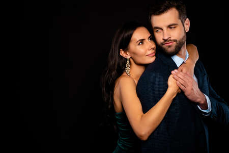 Close up side profile photo pair classy she her chic mistress he him his hold only my mine guy hands arms chest piggyback position wear blue plaid costume jacket green dress isolated black background