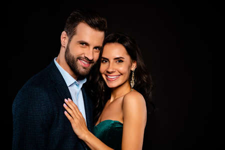 Close up side profile photo beautiful she her wife earrings he him his husband married spouse celebrities pop stars actors hands chest toothy wear costume jacket green dress isolated black background