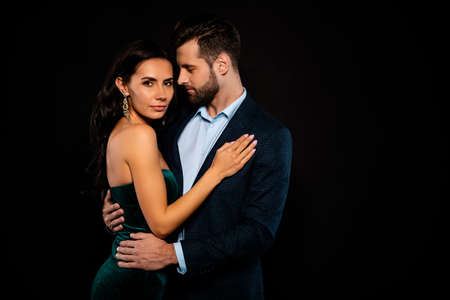 Close up side profile photo beautiful she her wife bride he him his husband fiance mrs mr married spouse protect hands slim waist hold close wear costume jacket green dress isolated black background