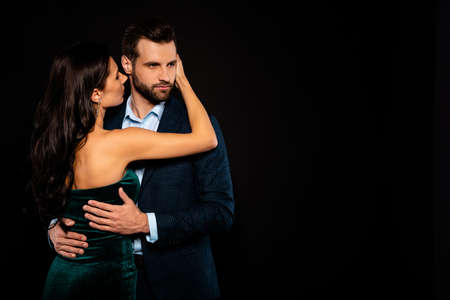 Close up back rear behind view photo beautiful she her wife he him his husband mrs mr married spouse protect hands thin waist hold close wear costume jacket green dress isolated black background