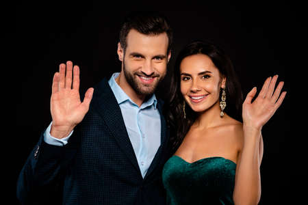 Close-up portrait of his he her she nice-looking attractive glamorous luxurious cheerful cheery two people waving isolated over black background