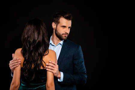 Close up back rear behind view photo beautiful she her classy wife he him his husband mrs mr married spouse hands carefully hold shoulders wear costume jacket green dress isolated black background