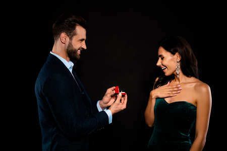 Profile side view portrait of nice chic gorgeous attractive luxury perfect fascinating cheerful cheery two person giving expensive dream rich wealthy guy isolated over black background