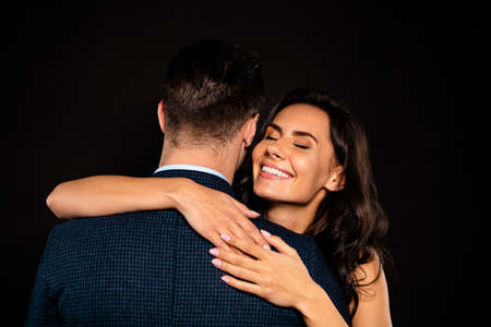 Close up back rear behind photo beautiful she her classy lady wife eyes closed he him his husband mrs mr married spouse slow dance hands shoulders wear costume jacket dress isolated black background