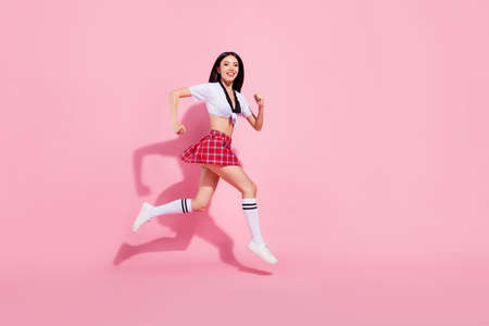 Profile side full length body size view of her she nice-looking attractive lovely charming slim fit cheerful straight-haired lady running fast isolated over pink pastel background