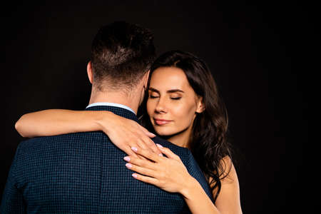 Close up back rear behind view photo beautiful she her lady wife eyes closed he him his husband mrs mr married spouse slow dance hands shoulders wear costume jacket dress isolated black background Stock Photo