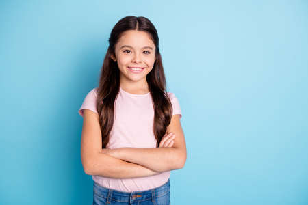 Portrait of cool cute friendly adorable girl feel glad content summer rest dressed pink outfit jeans isolated on blue background Banque d'images