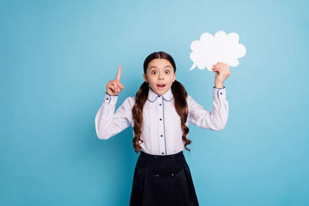 Portrait of astonished kid hold hand paper cloud wear white stylish trendy skirt blouse isolated over blue background