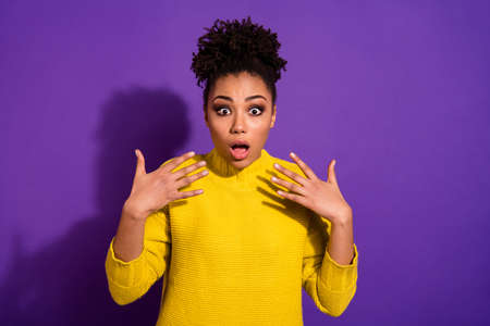 Portrait of frustrated astonished person wear trendy pullover sweater isolated over purple violet background Foto de archivo