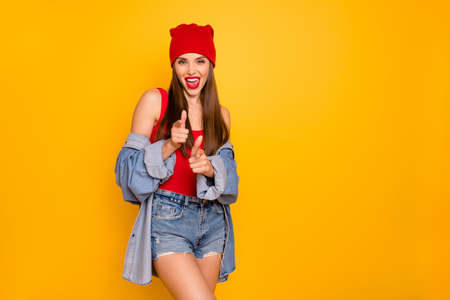 Close up photo of funky lady bright lips nice colorful look indicate fingers it is you symbol wear sun specs red body tank-top denim shorts blazer Stock Photo