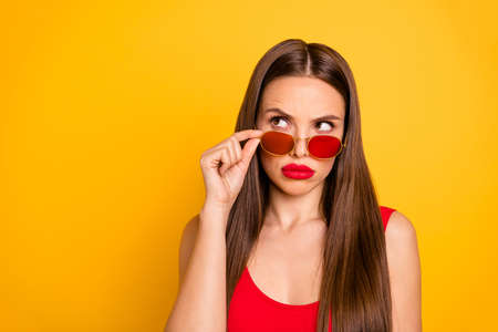 Close up photo of amazing beautiful lady have doubts think over important decision plump bright lips wear sun specs red body tank-top