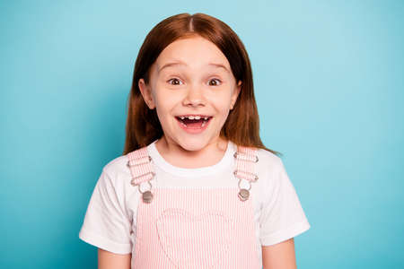 Close up photo of astonished kid hear unbelievable novelty scream isolated blue background