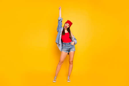 Full size photo of funky amazing lady street style hand raised up want dance wear red body tank-top denim shorts blazer shoes Stock Photo